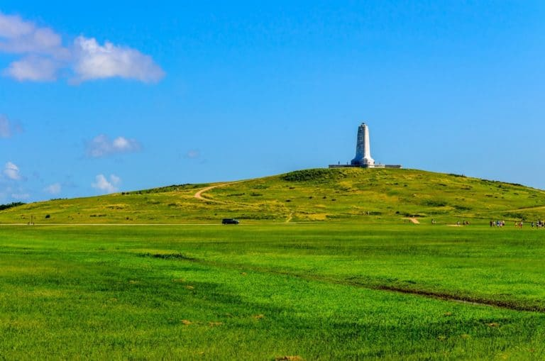 a panorama of the Wright Brothers National Monument on top of a tall hill