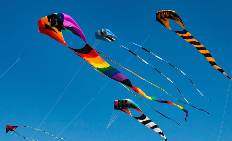 Large colorful kites against a blue sky