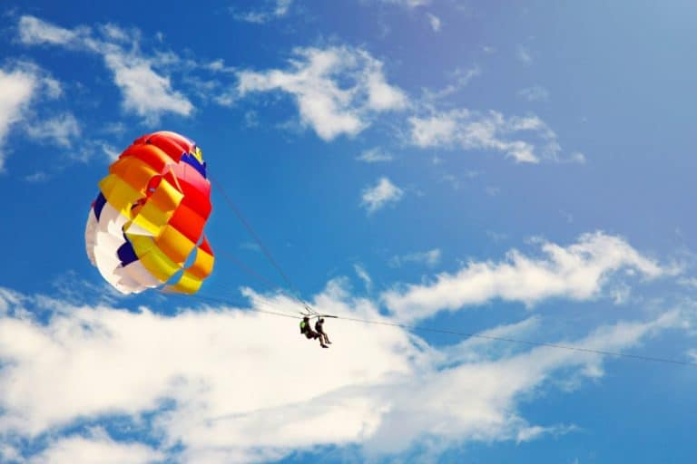 parasailing against the sky