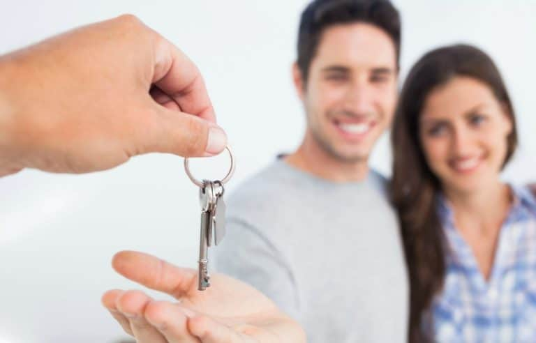 Couple Being Handed New House Key